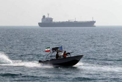 An Iranian gunboat, far too close to US military vessels off the coast of Iran