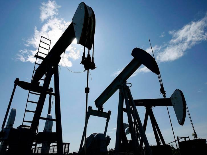 <figcaption>Pumpjacks at work pumping crude oil near Halkirk, Alberta   Photo: Larry MacDougal, The Canadian Press</figcaption>