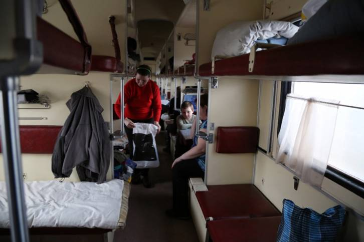 <figcaption>Displaced families from Debaltseve and surrounding areas moved to Sloviansk, Ukraine, to escape the violence and now live in a railway car at Sloviansk railway station   Photo: Abeer Etefa, WFP</figcaption>