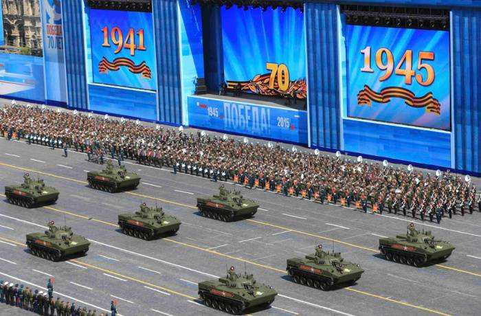 <figcaption>The parade was declared by the Kremlin to be the largest military show in history.</figcaption>