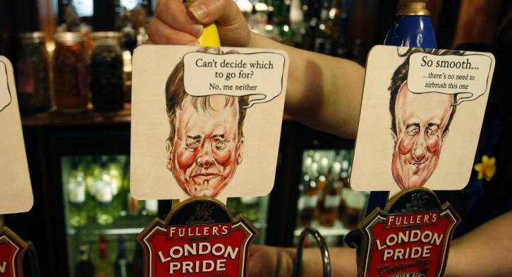 Beer pumps in a Westminster pub are coloured and decorated with the British main political party politicians | Photo: AP