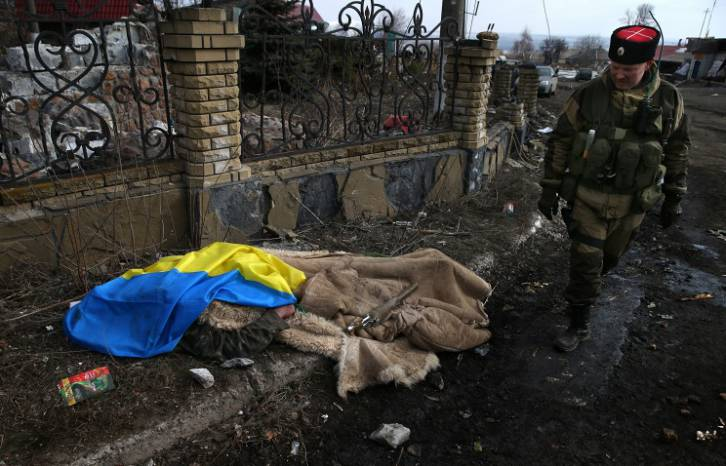 <figcaption>A Cossack fighter next to the body of an Ukrainian soldier</figcaption>