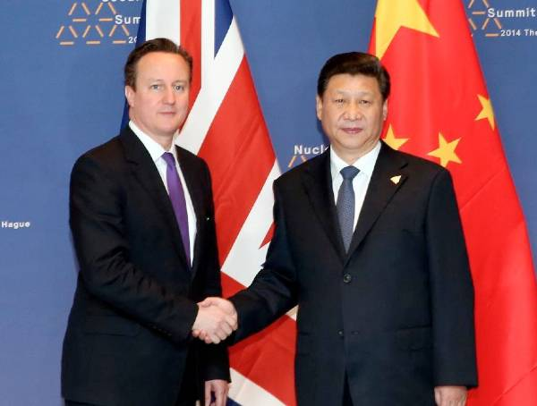 <figcaption>File photo of Chinese President Xi Jinping (R) meeting with British Prime Minister David Cameron in The Hague, the Netherlands, March 25, 2014 [Xinhua]</figcaption>