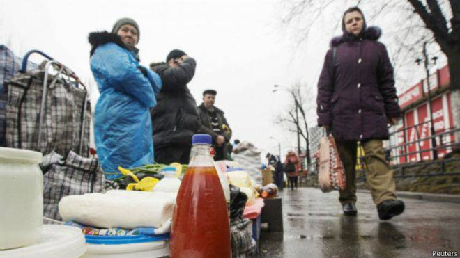 Vendors sell fruit, vegetables and homemade food items along a street in Kiev