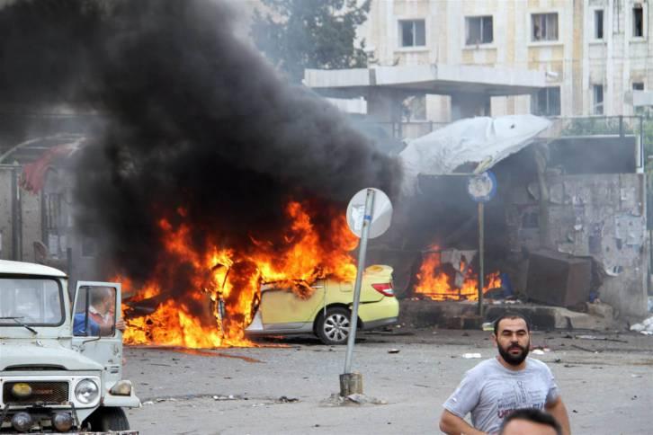 <figcaption>A recent 'moderate' bomb blast near Tartus</figcaption>