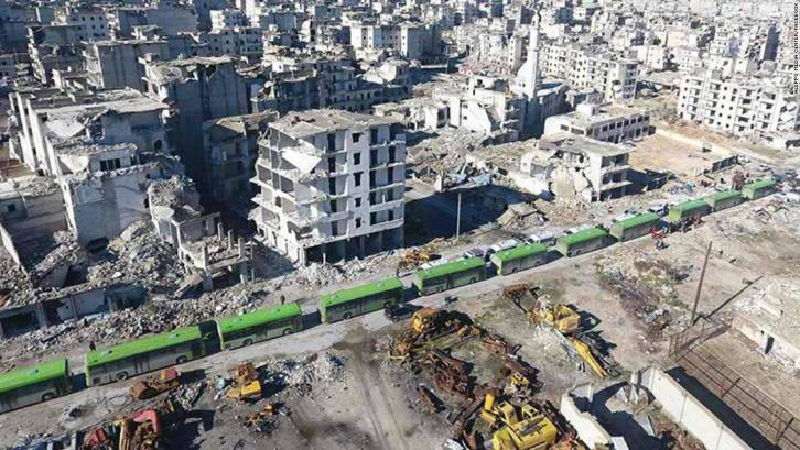 <figcaption>Famous green buses waiting to evacuate al-Qaeda and friends from Aleppo city in a Syrian-rebel deal last December</figcaption>