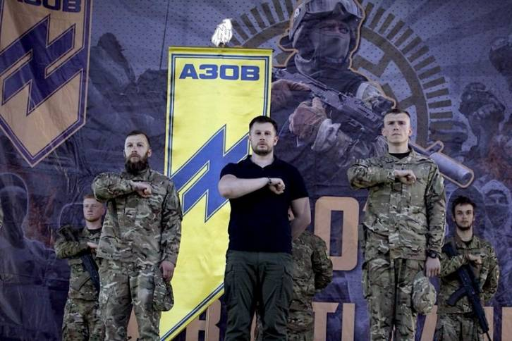 "<figcaption>The Azov Battalion uses the Nazi Wolfsangel symbol as its logo. Its founder Andriy Biletsky (center) has moved to ban ""race mixing"" in the Ukranian parliament</figcaption>"