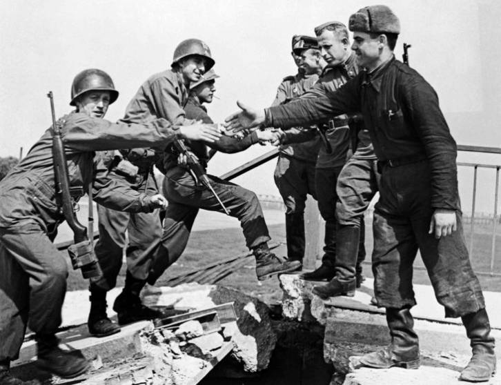 <figcaption>American and Soviet troops symbolically shake hands across the Elbe River on April 25, 1945, in the final days of World War II in Europe</figcaption>