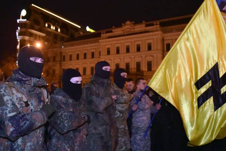<figcaption>Volunteers from the right-wing Azov battalion hold a ceremony in Kiev</figcaption>