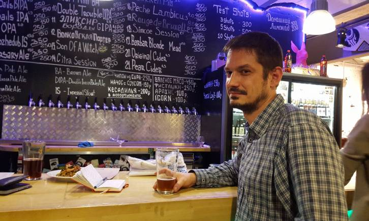 <figcaption>Luhn tries a Russian craft beer bar. At least two dozen have opened in Moscow since the summer of 2014</figcaption>