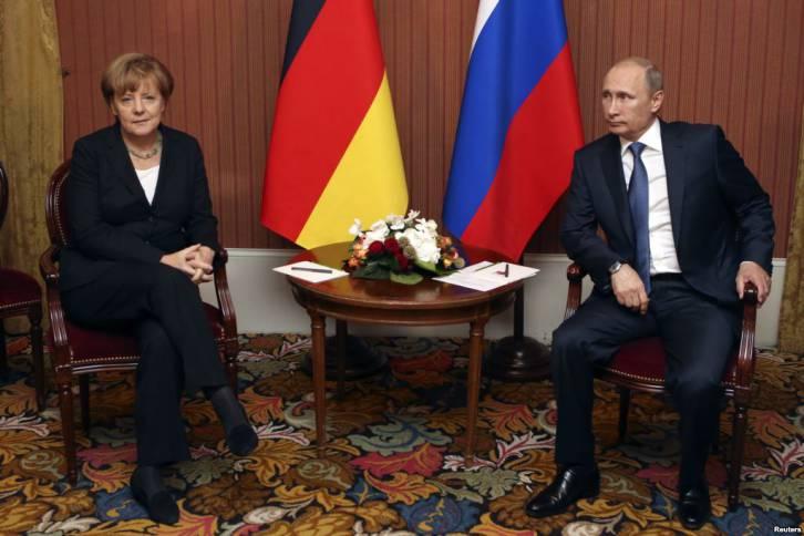 <figcaption>Putin makes Merkel wait</figcaption>