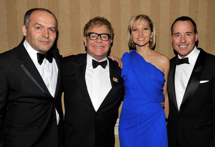 <figcaption>Social climbers: Pinchuk and his wife Olena. They love a good party and have perfected the art of buying their way into anything.  Here with Elton John.</figcaption>