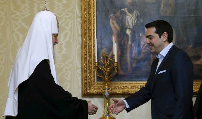 <figcaption>Greek Prime Minister Alexis Tsipras meets with Patriarch of Moscow and All Russia Kirill in Moscow Apr. 9. | Photo: Sergei Karpukhin, Reuters</figcaption>