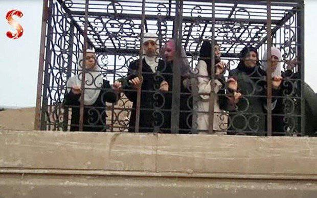 <figcaption>Ghouta rebel's claim to fame: driving around caged minority civilians as human shields</figcaption>