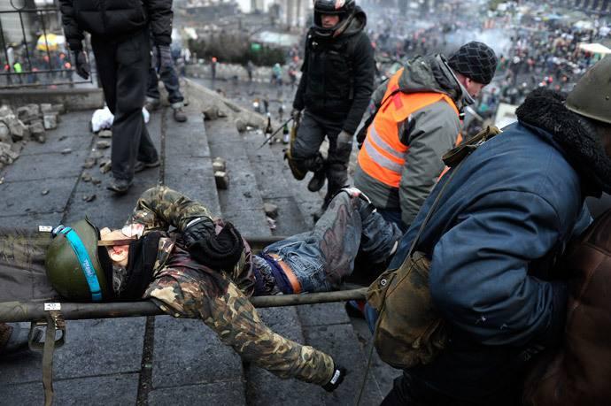 <figcaption>Скорее всего, этого протестующего застрелили свои</figcaption>