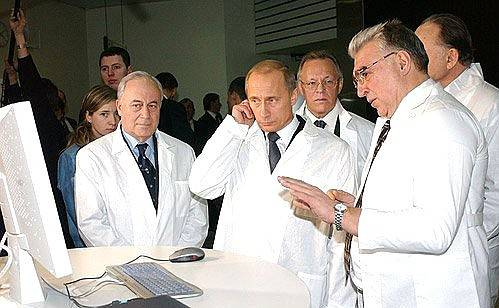 <figcaption>Just a random picture of top Russian para-psychologists, explaining how they managed to hypnotize Donald Trump in a hotel room in Moscow in the 90s, and  how they now control him remotely from an Iphone 7</figcaption>