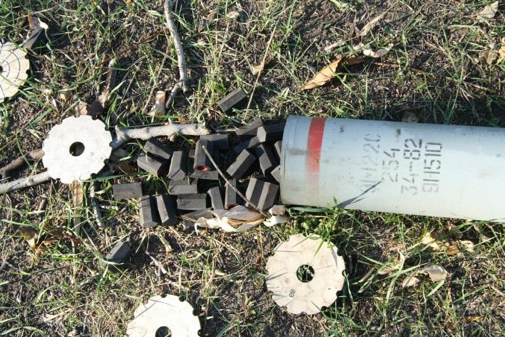 <figcaption>The rocket body of a 9M22S found by VICE News at an abandoned hilltop Ukrainian position approximately 11 miles from Iloviask. The red stripe denotes an incendiary weapon according to the Eastern Bloc munitions marking system</figcaption>