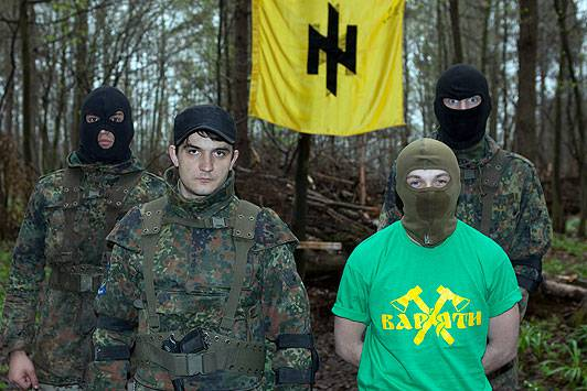 <figcaption>Thugs ... Maksymiv, in Berserker T-shirt, and Syvachuk at the camp | Photo:  Doug Seeburg, The Sun</figcaption>