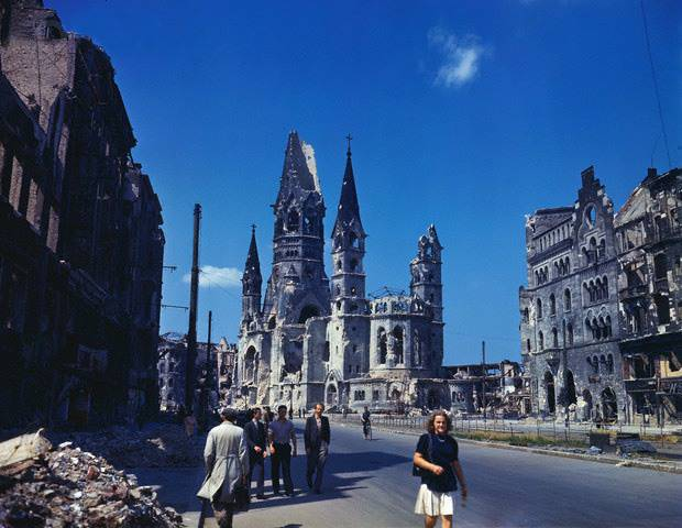 <figcaption>Kaiser Wilhelm Memorial Church and surrounding ruins in Berlin in summer 1945</figcaption>