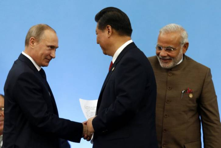 <figcaption>Три главных политика современного мира: русский Владимир Путин, китаец Си Цзиньпин и индиец Нарендра Моди</figcaption>