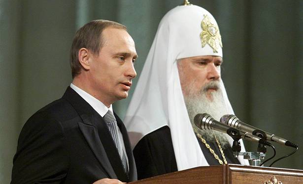<figcaption>Putin has been very consistent on this - here with Russian patriarch in 2000...</figcaption>