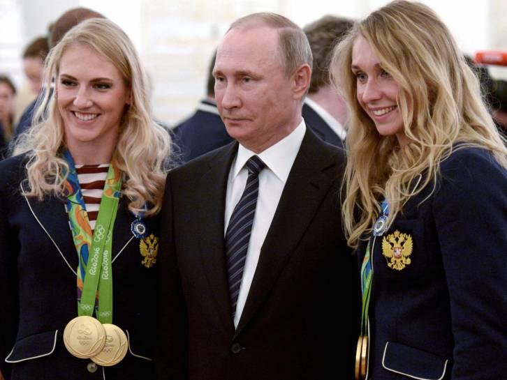 <figcaption>Putin with Olympic athletes</figcaption>
