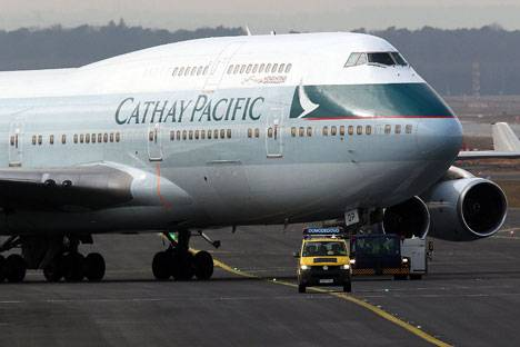 <figcaption>A Cathay Pacific Boeing B747-400 Aircraft on the runway at an airport | Photo: Reuters</figcaption>