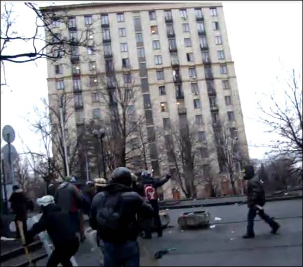 <figcaption>YouTube screenshot of shots being fired on police and protesters from Hotel Ukraina on Feb 20, 2014</figcaption>
