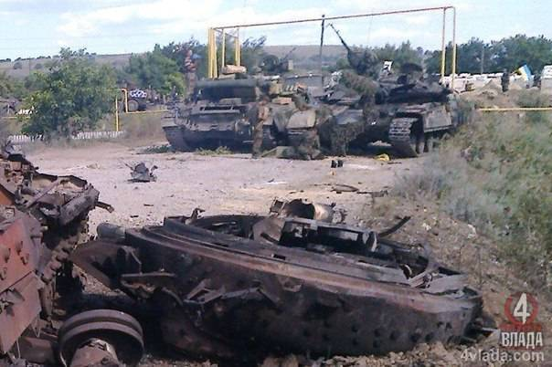 <figcaption>Kiev army military tanks destroyed by the rebels in the last days of covert-fighting</figcaption>