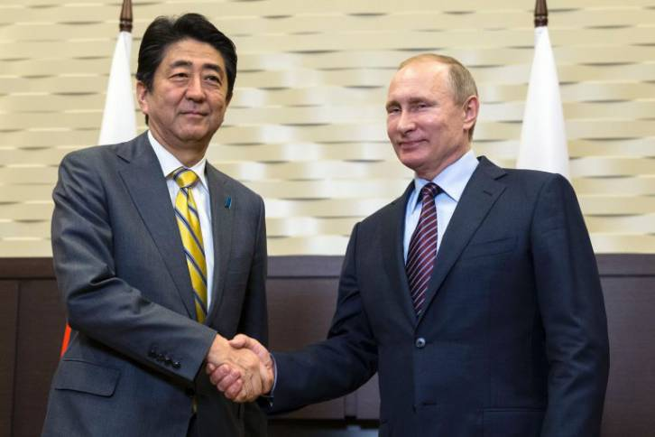 <figcaption>Japanese Prime Minister Shinzo Abe shakes hands with Russian President Vladimir Putin during a meeting in Sochi on May 6, 2016.</figcaption>