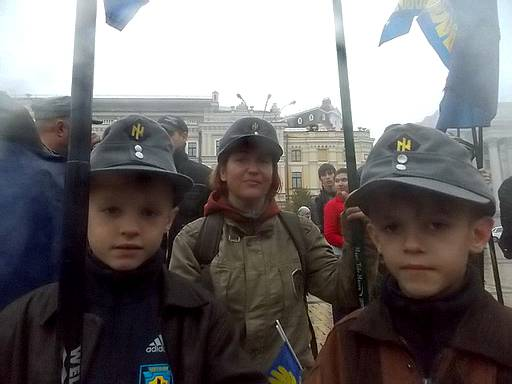 <figcaption>Ukrainian children with Nazi insignia </figcaption>