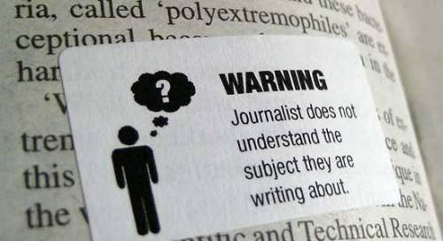 <figcaption>Надпись на плакате: Внимание! Журналист не понимает, чего несет!</figcaption>