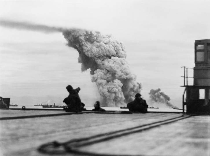 <figcaption>Smoke rising from ammunition ship Mary Luckenbach of Allied convoy PQ-18, 13 Sep 1942 (WWII Database)</figcaption>