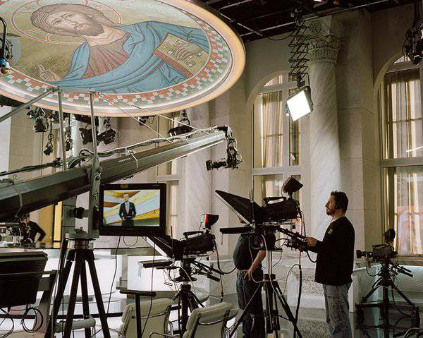 <figcaption>Inside Tsargrad TV's studios, dominated by a cathedral cupola</figcaption>