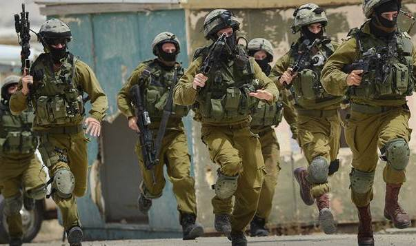 <figcaption>This is actually a photograph of Israeli soldiers chasing down brown children in Gaza</figcaption>