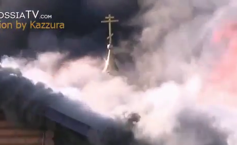<figcaption>A church going up in flames near Donetsk airport</figcaption>