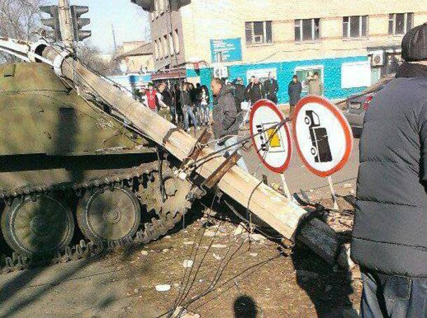 <figcaption>Ukrainian armored vehicle stands in the street of Kostyantynivka after hitting and killing an 8-year-old girl and her aunt.</figcaption>