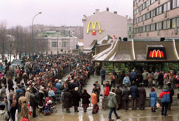 <figcaption>Waiting in 1990 for a first taste of freedom</figcaption>