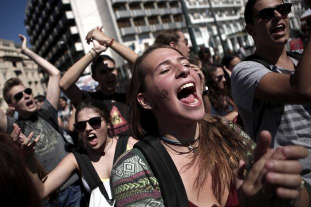 <figcaption>Greek students in Athens, October 2, 2014, protesting austerity measures</figcaption>