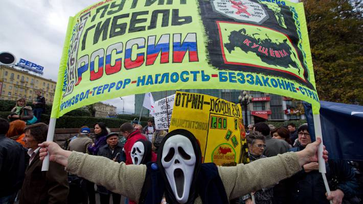 "<figcaption>Colorful example of a self-hating Russian... Probably not only SELF-hating | Banner says: ""Putin is Russia's doom!""</figcaption>"