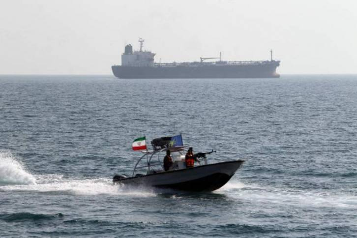 <figcaption>An Iranian gunboat, far too close to US military vessels off the coast of Iran</figcaption>