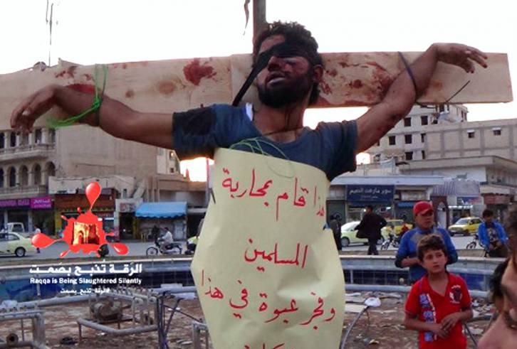 <figcaption>A Christian crucified by ISIL</figcaption>