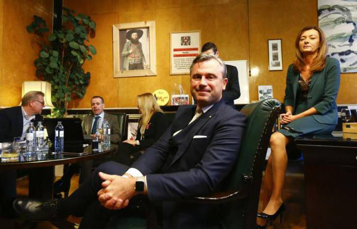 <figcaption>Austrian far-right Freedom Party (FPOe) presidential candidate Norbert Hofer and his wife Verena wait for the first projections in his office in Vienna, Austria, Dec. 4, 2016.</figcaption>