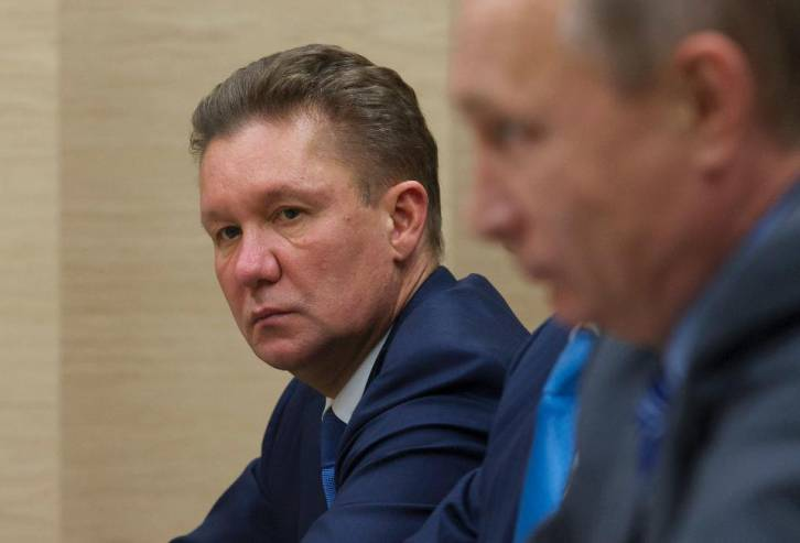 <figcaption>Gazprom CEO Alexei Miller with Russian President Vladimir Putin in the foreground. Gazprom just got served a $6.8 billion legal claim by the Ukrainian government. (Photo by IVAN SEKRETAREV/AFP/Getty Images)</figcaption>