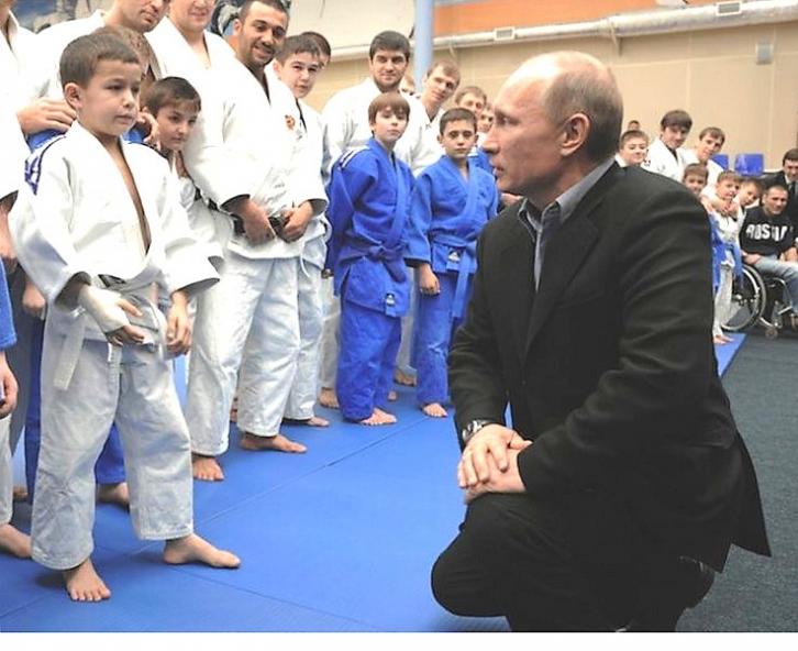 <figcaption>Judo Master Vladimir Putin  Speaking to a boy with an injured hand </figcaption>