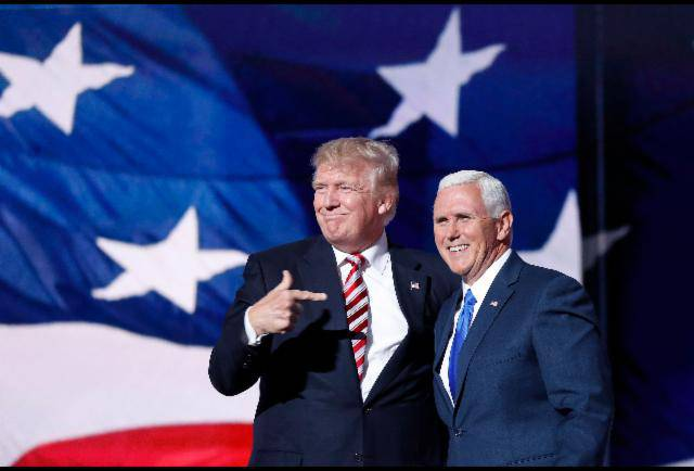 <figcaption>President elect Donald Trump points towards his vice president Mike Pence. Trump was elected in a close election on Tuesday. The world reacted with shock and dismay as if America had somehow let them down. (AP Photo/Mary Altaffer)</figcaption>
