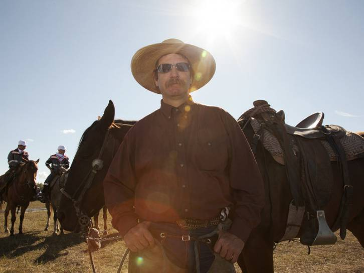 <figcaption>Shawn Weekes, an American cowboy from Texas, at the Russian rodeo. Irina Zhorov/WHYY</figcaption>