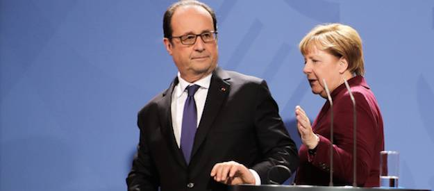 <figcaption>German chancellor Angela Merkel, right, and French president Francois Hollande after a meeting with the leaders of Russia and Ukraine in Berlin on Oct. 20. Photo: AP</figcaption>