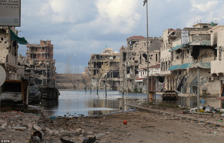 "<figcaption>This is the result of NATO bombing of Sirte to ""enforce the no-fly zone"" in Libya.</figcaption>"