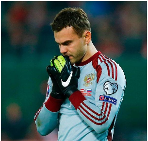"""<figcaption>""""I am Orthodox Christian. For me faith is what nourishes your life, helps you cope with anything. The main thing is to be guided by pure thoughts in all that you do."""" - Igor Akinfeev, Russian football player</figcaption>"""